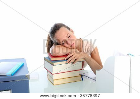 Exhausted Student Sleeping On Books