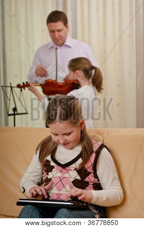 Child playing with tablet - family scene
