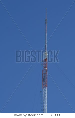 Tall Communication Tower Over Blue Sky