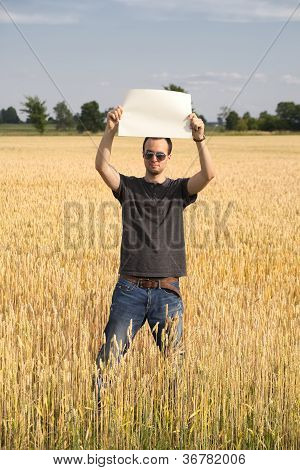 Farmer Guy In Wheatfield Holding Blank Sign