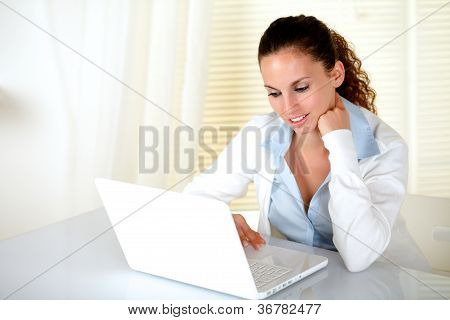 Pensive Young Woman Browsing The Internet