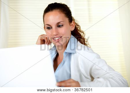 Smiling Young Woman Browsing The Internet