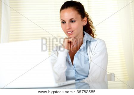 Pensive Attractive Young Female Using Her Laptop