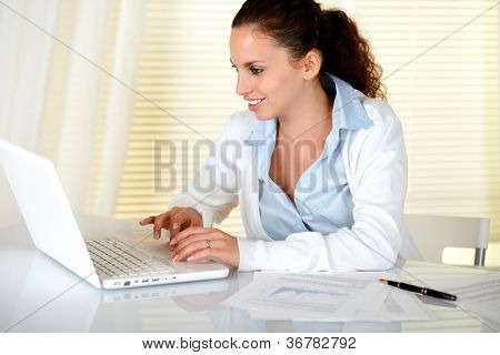 Smiling Caucasian Secretary Using Her Laptop