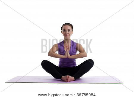 young woman sit in lotos as yoga asana on mat