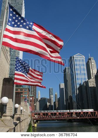U.S FLAGS AND EL TRAIN IN DOWNTOWN CHICAGO