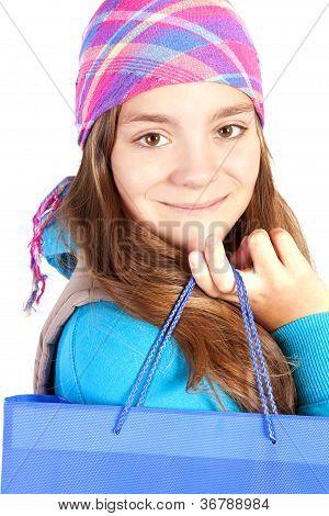 Smiling Girl Holding Shooping Bag Over White