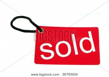 Red Paper Tag Labeled With Sold Words