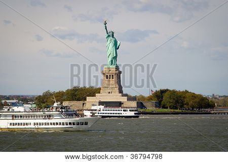 Tourists Flocking To The Statue Of Liberty, New York