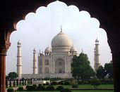 stock photo of mumtaj  - The Taj Mahal in Agra India viewed through an archway - JPG