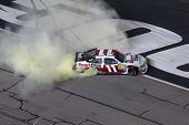 ATLANTA, GA - SEP 02, 2012:  Denny Hamlin (11) does his burnout after winning the AdvoCare 500 at th