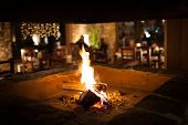 stock photo of chalet interior  - Cosy fireplace in a mountain chalet - JPG