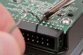 Extreme Closeup Of Soldering A Harddrive poster