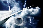 stock photo of accident emergency  - airplane crash in a storm with lightning concept - JPG
