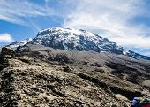 stock photo of kilimanjaro  - Wispy clouds crown the Kibo cone - JPG