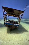 pic of piccolo  - a boat and the reflexin the zanzibar - JPG