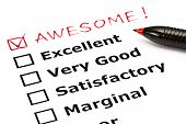 stock photo of recommendation  - Awesome added on top of a customer evaluation form with red pen