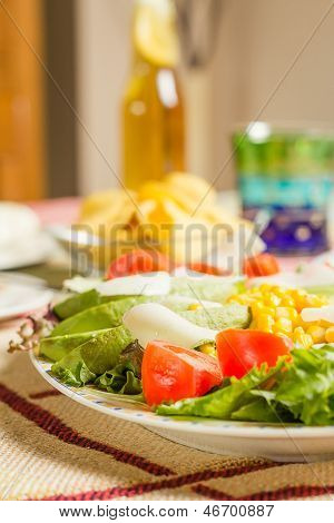 Traditional Mexican Food With A Plate Of Fresh Salad And A Bowl Nachos