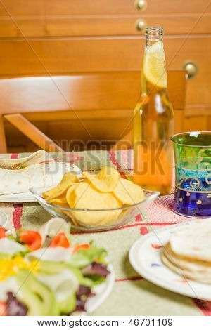Traditional Mexican Food With A Bowl Of Nachos, A Plate Of Chicken Fajita, Tortillas, Fresh Salad An