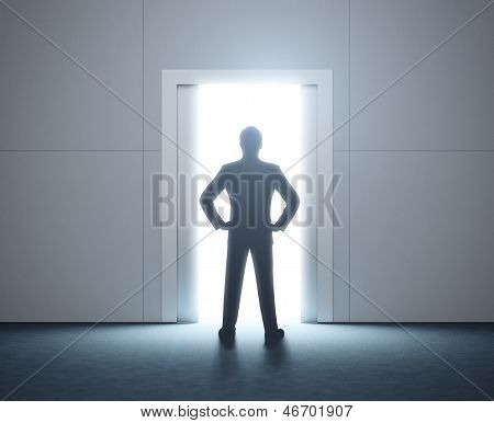 Silhouette of a man. Shining doorway