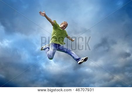 Jump of man under sky with clouds
