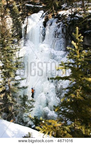 Mountain Climber On Frozen Waterfall