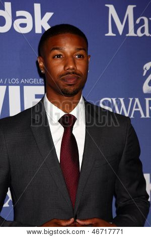 LOS ANGELES - JUN 12:  Michael B. Jordan arrives at the Crystal and Lucy Awards 2013 at the Beverly Hilton Hotel on June 12, 2013 in Beverly Hills, CA