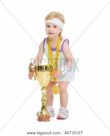 Happy Baby In Tennis Clothes Holding Medal And Goblet