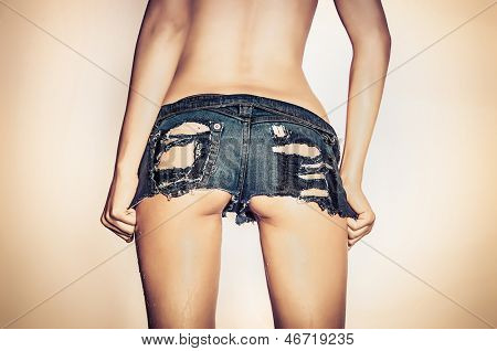 Sexy woman wearing denim shorts with holes