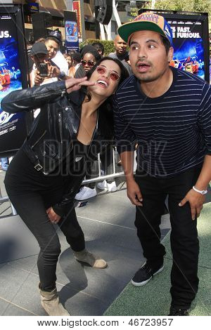 LOS ANGELES - JUN 12: Michelle Rodriguez, Michael Pena at the Turbo-Charged Party and Surpise Pop-Up concert for E3 Gaming Convention at Nokia Plaza L.A. LIVE on June 12, 2013 in Los Angeles, CA
