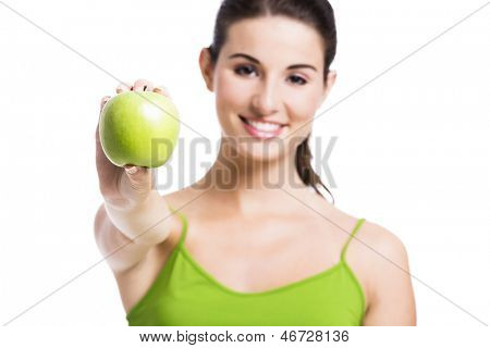 Healthy woman showing a green apple, isolated over a white background