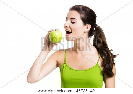 Healthy woman biting a fresh apple, isolated over a white background
