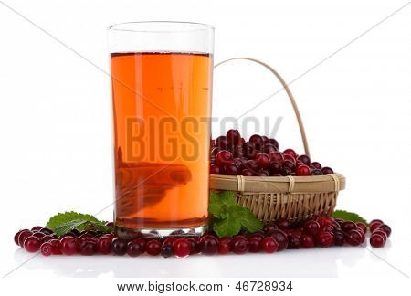 Glass of cranberry juice and ripe red cranberries, isolated on white