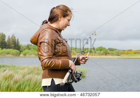 Young fisher-woman with a rode