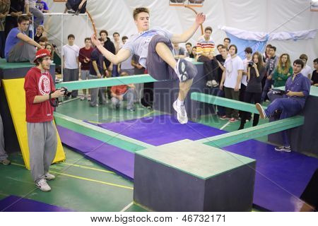 MOSCOW - NOV 17: A man in a jump on the 5th parkour contest to move at the University of Physical Education, Max Attack: Death Circle, on Nov 17, 2012 in Moscow, Russia