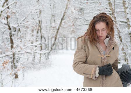 Winter Landscape Woman Standing Pensive In The Snow