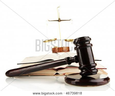 Wooden gavel, golden scales of justice  and books isolated on white