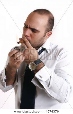 Man Light A Cigarette