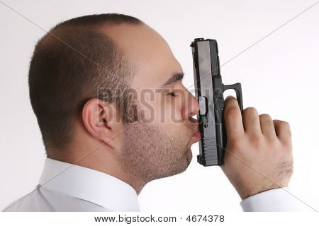 Man Kissing A Gun
