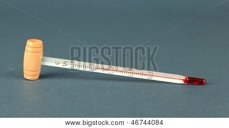 Wine thermometer on grey background