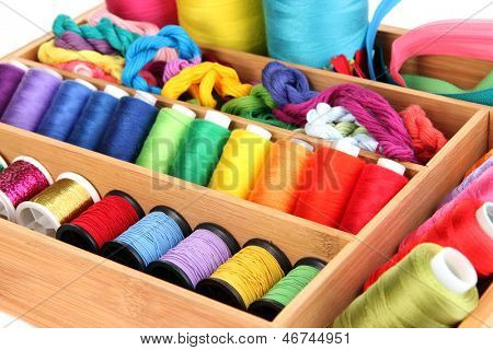 Sewing accessories in wooden box close up