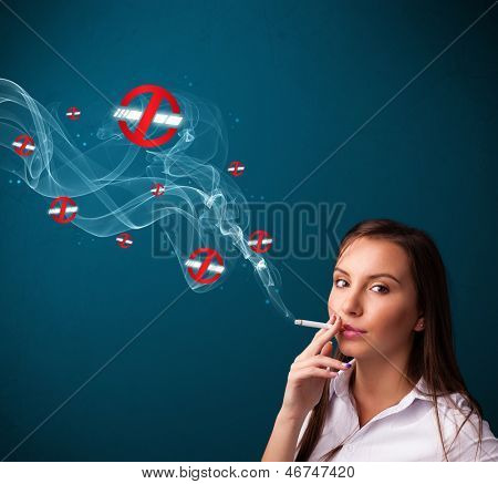 Beautiful young woman smoking dangerous cigarette with no smoking signs