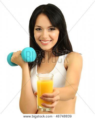 Girl with fresh orange juice and dumbbell isolated on white