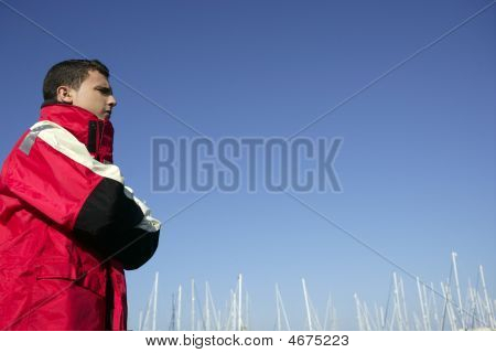 Handsome Boy On Harbor With Red Marine Coat