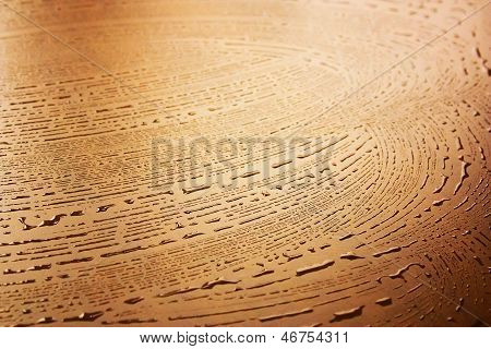 Water Drops On A Wooden Table