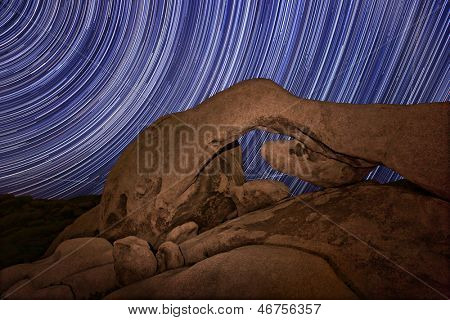 Star Trail Streaks over the Rocks of Joshua Tree Park