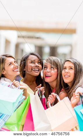 Group of shopping women looking up daydreaming
