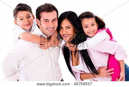 Happy family portrait smiling together - isolated over a white background