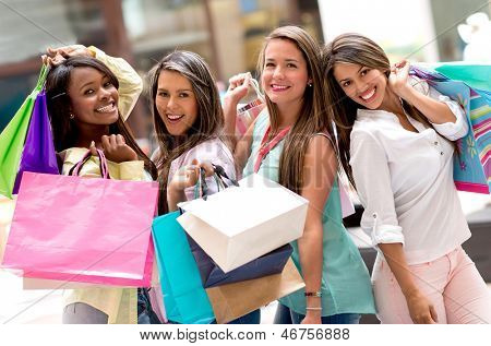 Beautiful group of shopping women looking very happy
