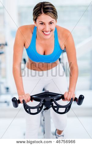 Fit woman working out at the gym
